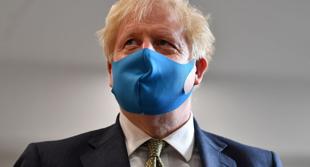 Britain's Prime Minister Boris Johnson, wearing a face mask, visits headquarters of the London Ambulance Service NHS Trust, amid the spread of the coronavirus disease (COVID-19), in London, Britain July 13, 2020