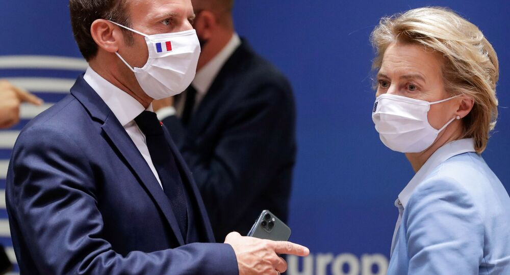 French President Emmanuel Macron (L) and President of the European Commission Ursula von der Leyen attend a last roundtable discussion following a four-day European summit at the European Council in Brussels, Belgium, July 21, 2020.
