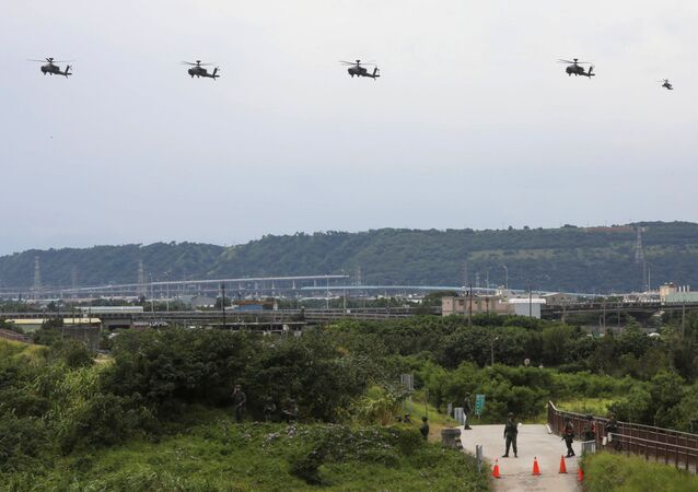 AH-64 Apache helicopters fly to location during the live-fire, anti-landing Han Kuang military exercise, which simulates an enemy invasion, in Taichung, Taiwan July 16, 2020.