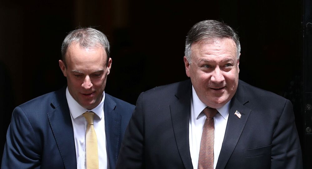 Britain's Foreign Secretary Dominic Raab and U.S. Secretary of State Mike Pompeo leave Downing Street in London, Britain, July 21, 2020