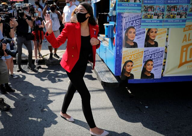 U.S. Rep. Alexandria Ocasio-Cortez (D-NY) waves as she makes a stop to greet voters during the Democratic congressional primary election in the Queens borough of New York City, New York, U.S., June 23, 2020