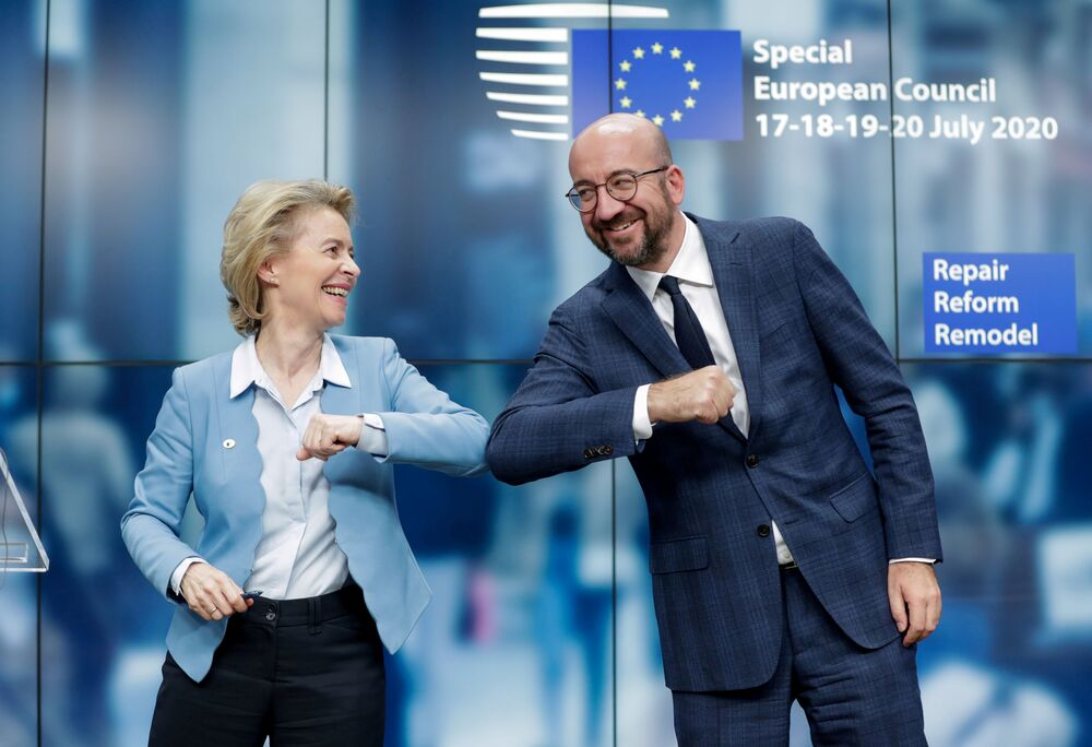 European Council President Charles Michel and European Commission President Ursula Von Der Leyen do an elbow bump at the end of a news conference following a four-day European summit at the European Council in Brussels, Belgium, 21 July 2020.