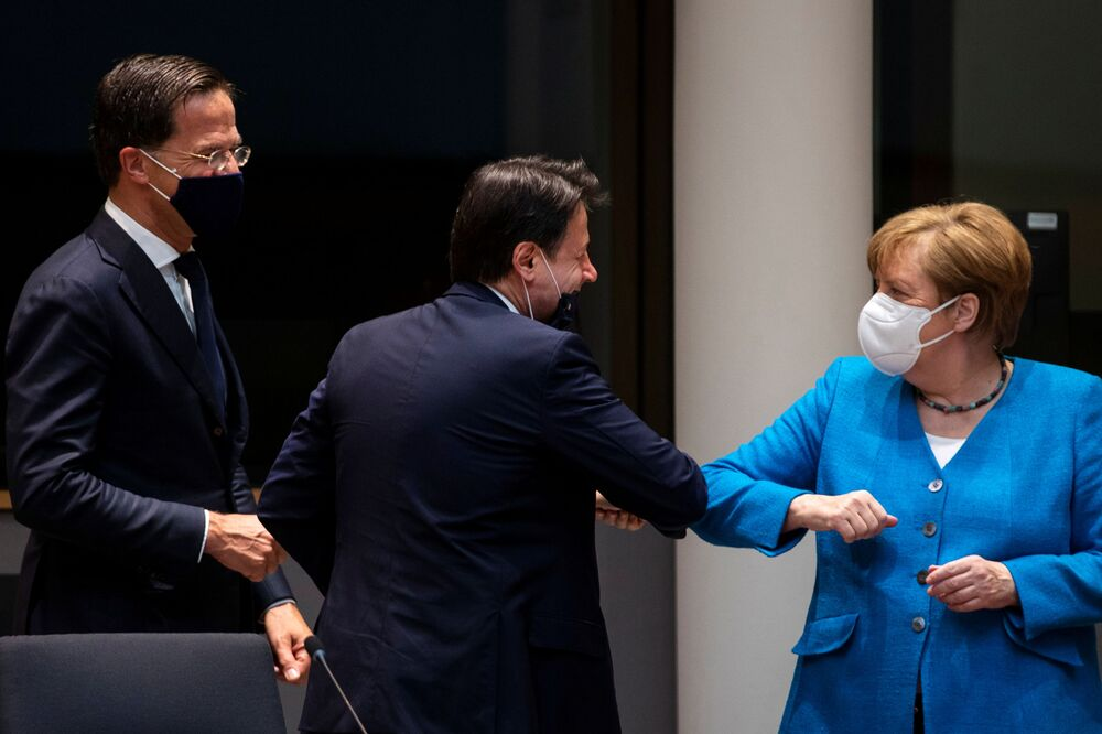 German Chancellor Angela Merkel greets Italy's Prime Minister Giuseppe Conte with an elbow bump during a meeting on the sidelines of the first face-to-face EU summit since the coronavirus disease (COVID-19) outbreak, in Brussels, Belgium 18 July 2020.
