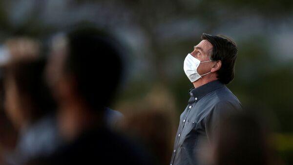 Brazil's President Jair Bolsonaro is seen during a ceremony to lower the Brazilian National flag down for the night, at the Alvorada Palace, amid the coronavirus disease (COVID-19) outbreak, in Brasilia, Brazil, 20 July 2020. REUTERS/Ueslei Marcelino - Sputnik International