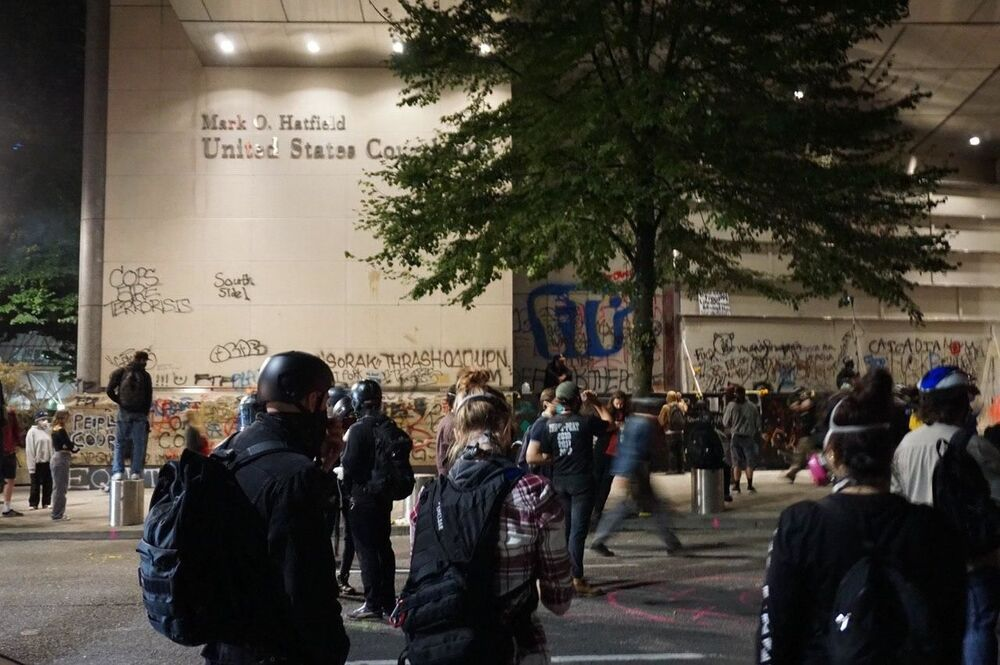 Demonstrators wearing masks and protective headwear during the protests in Portland