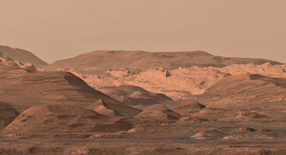 This composite image looking toward the higher regions of Mount Sharp was acquired during mission sol 1099 (September 9, 2015), using Curiosity rover's right-side 100 mm mast camera.