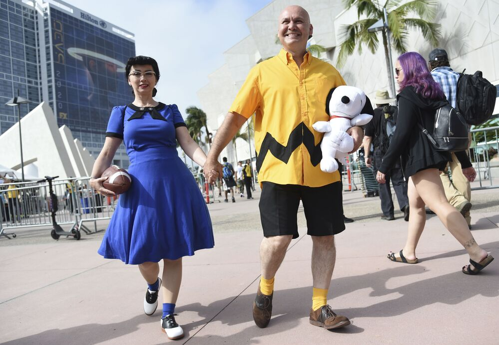 Lucy Capuchino, left, and Miguel Capuchino, of San Diego, dressed as Lucy and Charlie Brown, attend day one of Comic-Con International on Thursday, July 18, 2019, in San Diego.