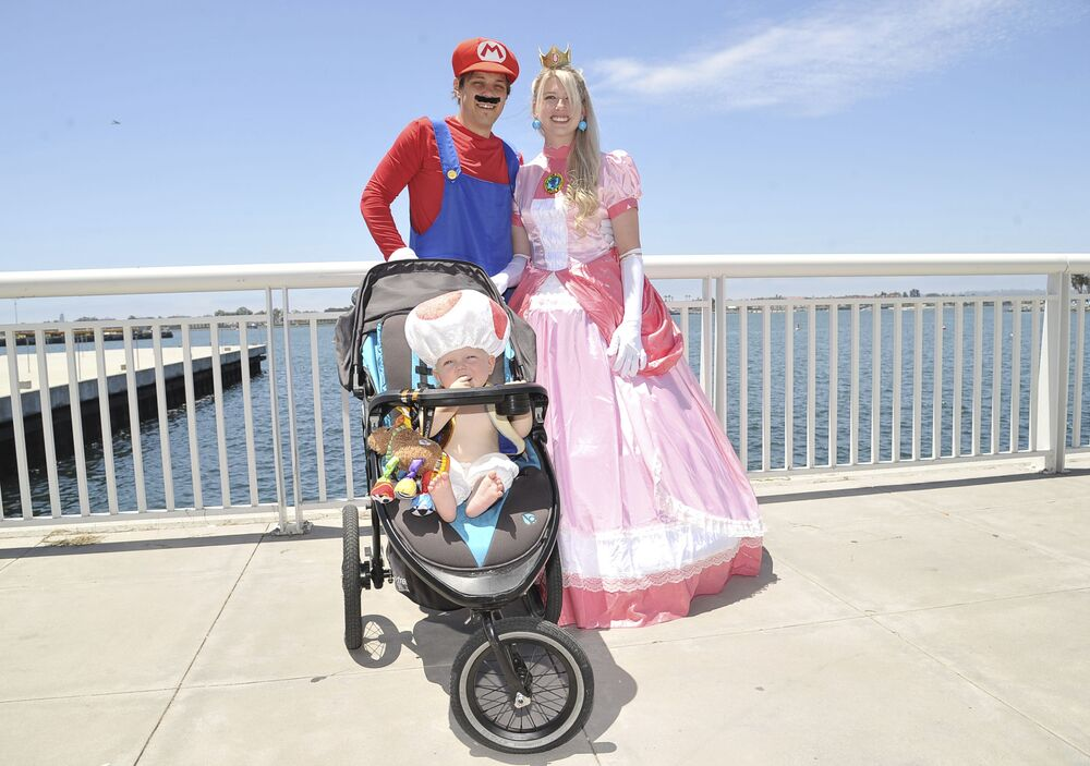 Family dressed as Mario Bros arcade heroes at San Diego Comic-Con 2019.