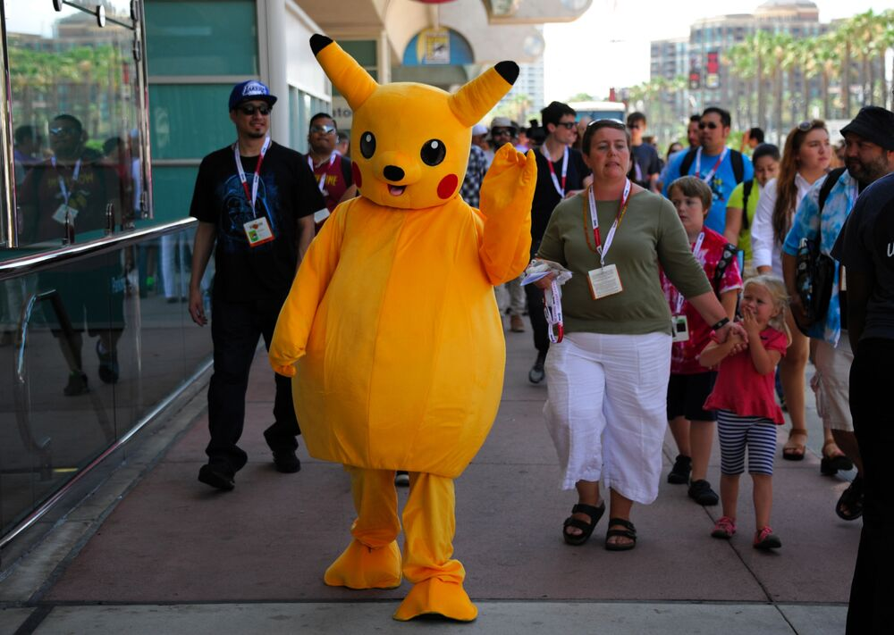 A fan dressed as Pokemon's Pikachu walks past the lines before Preview Night at Comic-Con International held at the San Diego Convention Center Wednesday 8 July 2015 in San Diego.