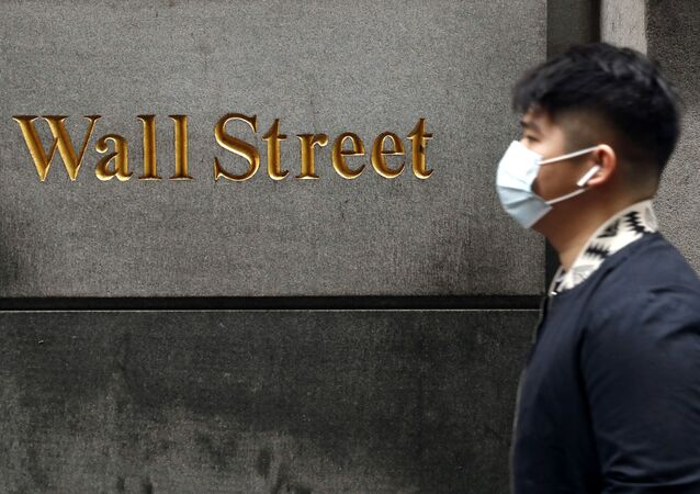 A man wears a protective mask as he walks on Wall Street during the coronavirus outbreak in New York City, New York, U.S., March 13, 2020