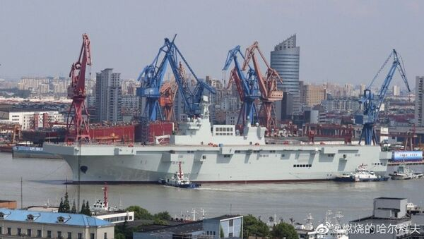 China's Type 075 landing helicopter dock (LHD), an aircraft carrier that carries amphibious assault forces, docked in Shanghai - Sputnik International
