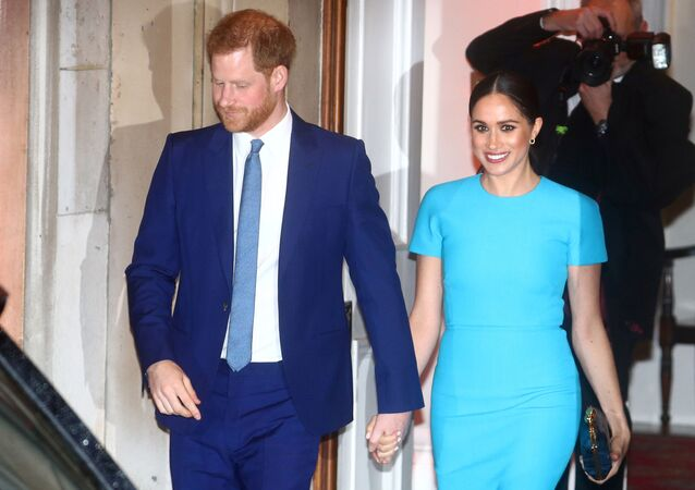 Britain's Prince Harry and his wife, Meghan, Duchess of Sussex, leave after attending the Endeavour Fund Awards in London, Britain, 5 March 2020