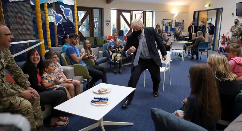 Britain's Prime Minister Boris Johnson reacts as he visits families in the community centre at RAF Lossiemouth, during a visit to the Highlands and Northern Isles of Scotland, in Moray, Scotland, Britain July 23, 2020