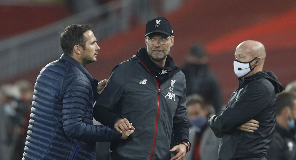 Soccer Football - Premier League - Liverpool v Chelsea - Anfield, Liverpool, Britain - July 22, 2020 Liverpool manager Juergen Klopp shakes hands with Chelsea manager Frank Lampard after the match, as play resumes behind closed doors following the outbreak of the coronavirus disease (COVID-19)