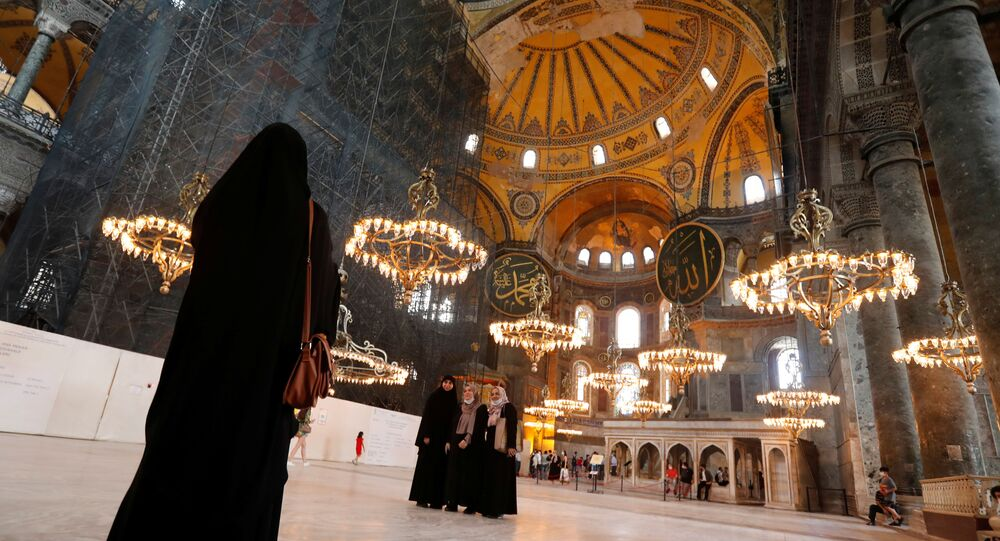 Visitors pose for a picture at Hagia Sophia or Ayasofya, a UNESCO World Heritage Site, in Istanbul, Turkey, July 10, 2020. Picture taken July 10, 2020