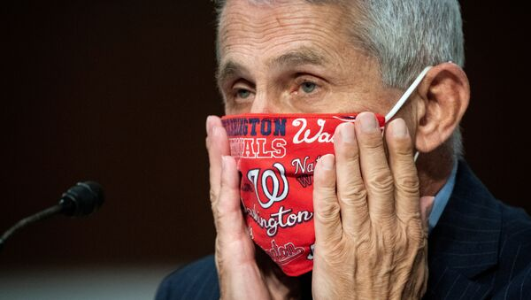 Anthony Fauci, director of the National Institute of Allergy and Infectious Diseases, adjusts his face mask during a Senate Health, Education, Labor and Pensions Committee hearing on efforts to get back to work and school during the coronavirus disease (COVID-19) outbreak, in Washington, 30 June 2020 - Sputnik International