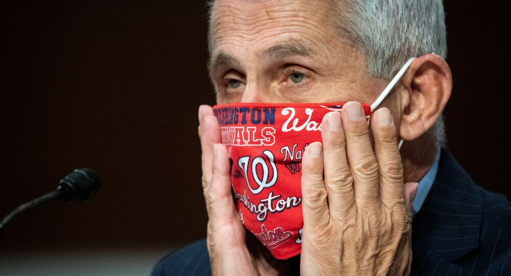 Anthony Fauci, director of the National Institute of Allergy and Infectious Diseases, adjusts his face mask during a Senate Health, Education, Labor and Pensions Committee hearing on efforts to get back to work and school during the coronavirus disease (COVID-19) outbreak, in Washington, D.C., U.S. June 30, 2020