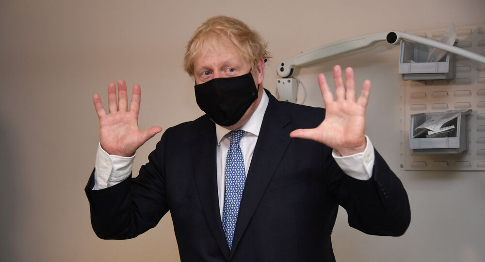 Britain's Prime Minister Boris Johnson visits the Tollgate Medical Centre in Beckton, London, Britain July 24, 2020