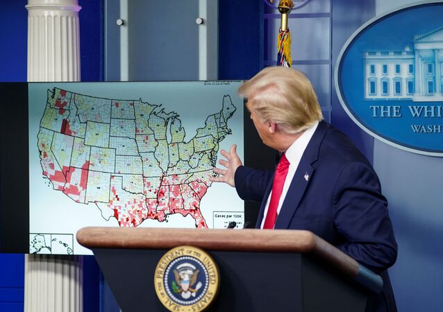 U.S. President Donald Trump points to a U.S. map of reported coronavirus cases as he speaks about reopening schools during a coronavirus disease (COVID-19) news briefing at the White House in Washington, U.S., July 23, 2020.