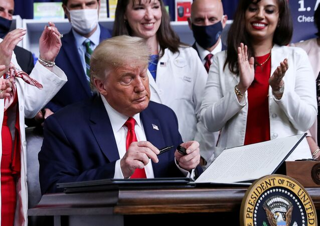 U.S. President Donald Trump signs an executive order on lowering drug prices during a ceremony in the Eisenhower Executive Office Building at the White House in Washington, U.S., July 24, 2020.