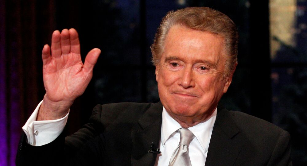 Television host Regis Philbin waves goodbye during his final show of on ABC's Live With Regis and Kelly in New York, November 18, 2011.