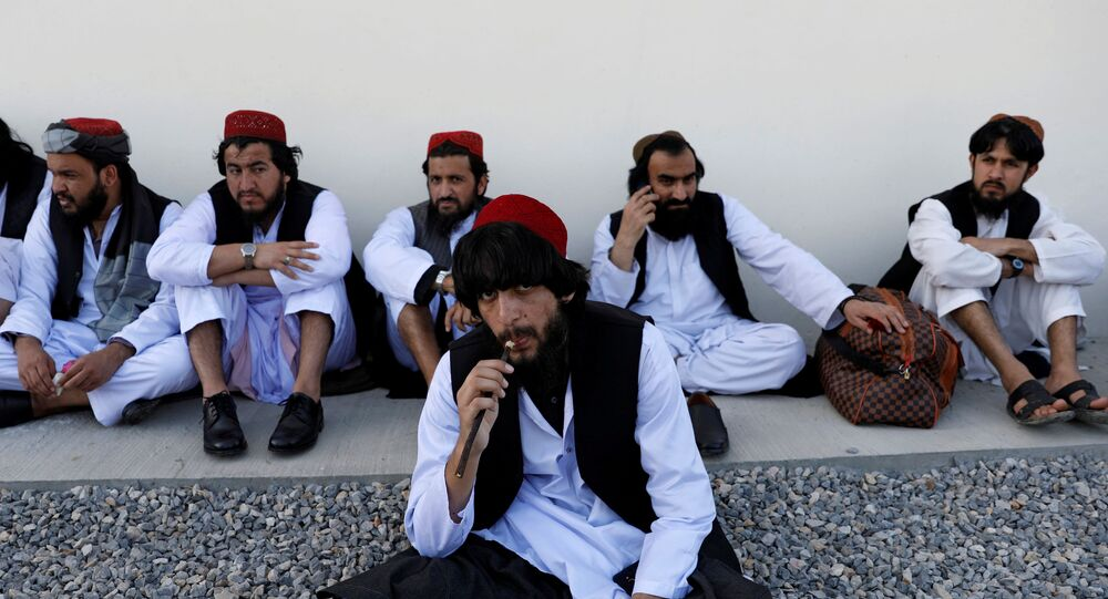 Afghan leader urges mega gathering to decide on 400 Taliban prisoners