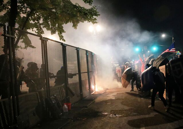 Federal law enforcement officers face off with protesters during a demonstration against police violence, the presence of federal officers, and racial inequality in Portland, Oregon, U.S., July 24, 2020. Picture taken July 24, 2020.