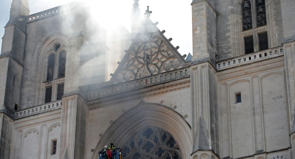 French firefighters battle a blaze at the Cathedral of Saint Pierre and Saint Paul in Nantes