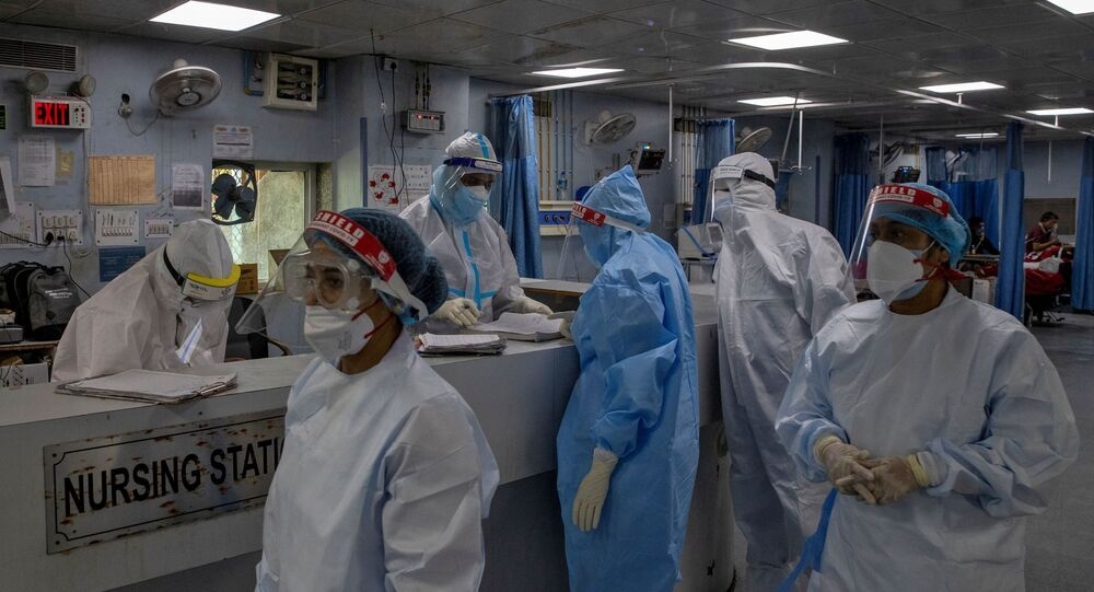 Medical workers wearing personal protective equipment (PPE) are seen inside an Intensive Care Unit (ICU) for patients suffering from the coronavirus disease