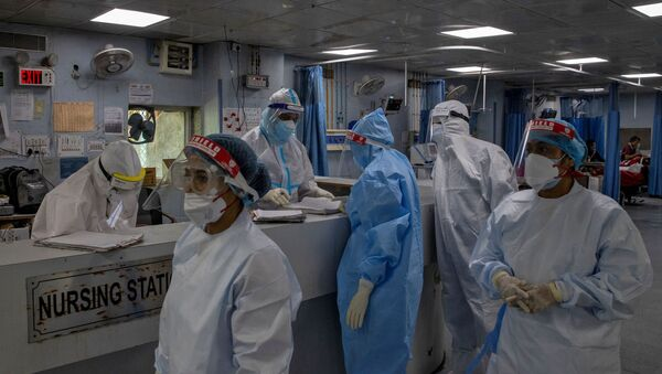 Medical workers wearing personal protective equipment (PPE) are seen inside an Intensive Care Unit (ICU) for patients suffering from the coronavirus disease - Sputnik International