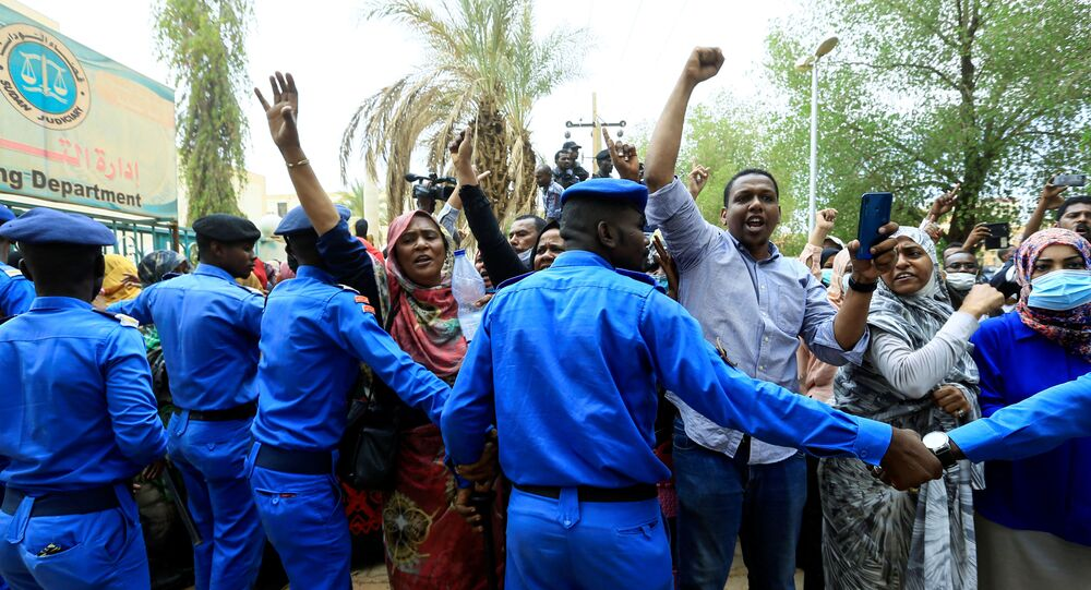 Sudanese police officers during the new trial against ousted President Omar al-Bashir
