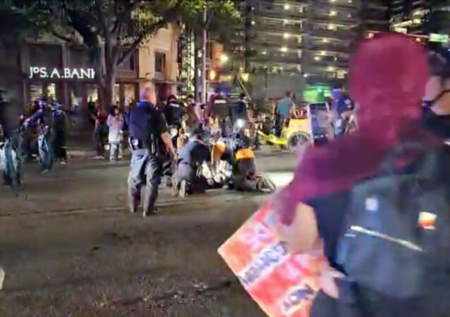 Police and protesters gather around a demonstrator who got shot after several shots were fired during a Black Lives Matter protest in downtown Austin, Texas, U.S., July 25, 2020 in this screen grab obtained from a social media video.