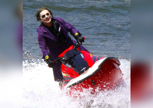A man dressed as the Joker jet skied around in the East River under the Brooklyn Bridge in Dumbo