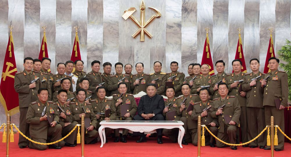 North Korean leader Kim Jong Un poses for a photograph after conferring Paektusan commemorative pistols to leading commanding officers of the armed forces on the 67th anniversary of the Day of Victory in the Great Fatherland Liberation War, which marks the signing of the Korean War armistice, in this undated photo released on July 27, 2020 by North Korean Central News Agency (KCNA) in Pyongyang