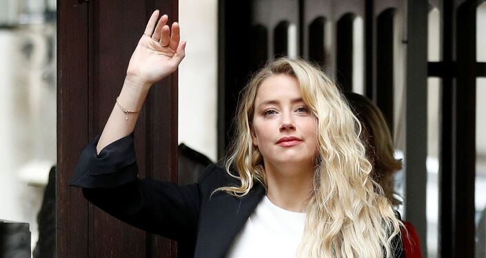 Actress Amber Heard arrives at the High Court in London on 27 July 2020.