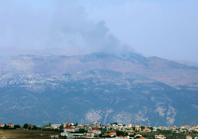 Smoke rises from the disputed Shebaa Farms area as seen from Marjayoun village in southern Lebanon, Lebanon July 27, 2020
