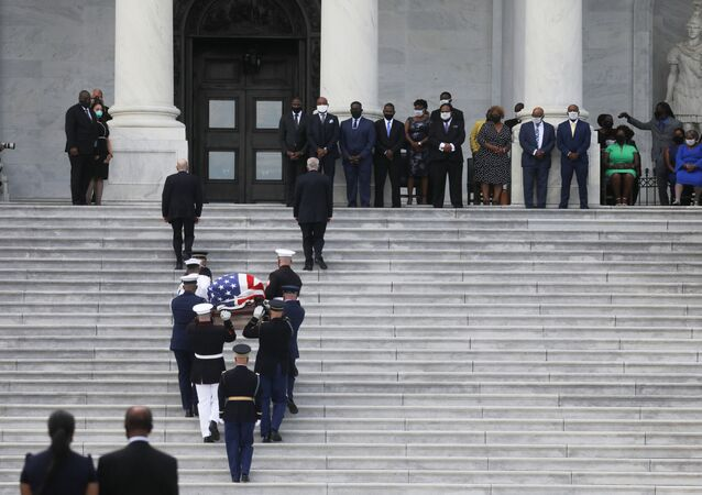 A U.S. military honor guard carries the casket of civil rights pioneer and longtime U.S. Rep. John Lewis (D-GA), who died July 17, up the steps of the U.S. Capitol to lie in state inside the Rotunda in Washington, U.S., July 27, 2020.