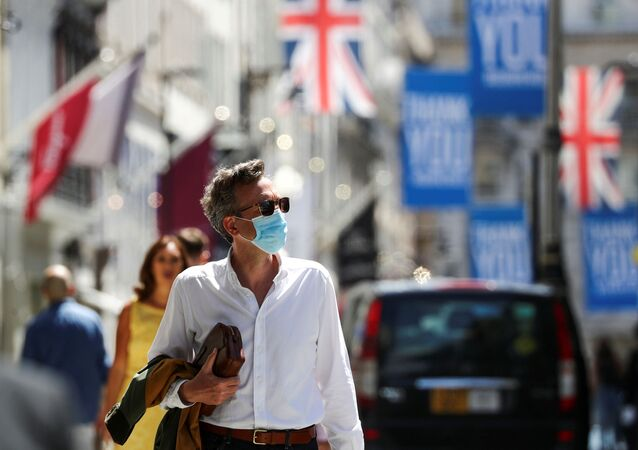 A shopper wears a face mask in Old Bond Street