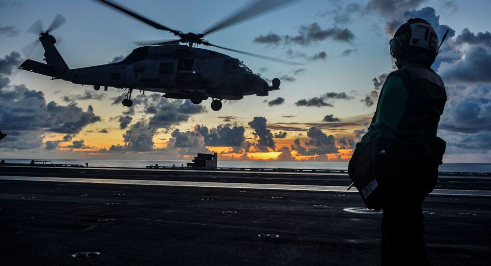 An MH-60R Sea Hawk helicopter launches during flight operations aboard the U.S. Navy aircraft carrier USS Ronald Reagan in the South China Sea July 17, 2020