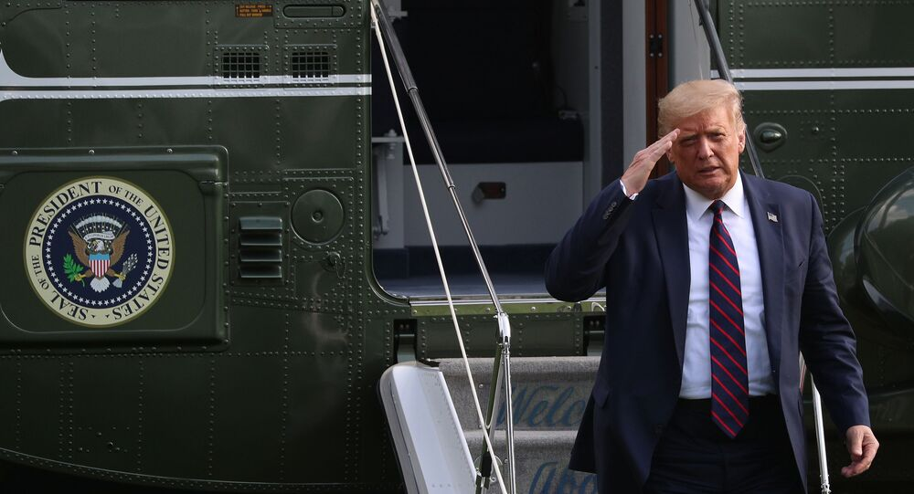 U.S. President Donald Trump walks from Marine One to the South Portico of the White House following a day trip to North Carolina, in Washington, U.S., July 27, 2020.