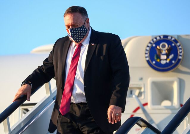 U.S. Secretary of State Mike Pompeo steps from his plane upon arrival in London, Britain, July 20, 2020.