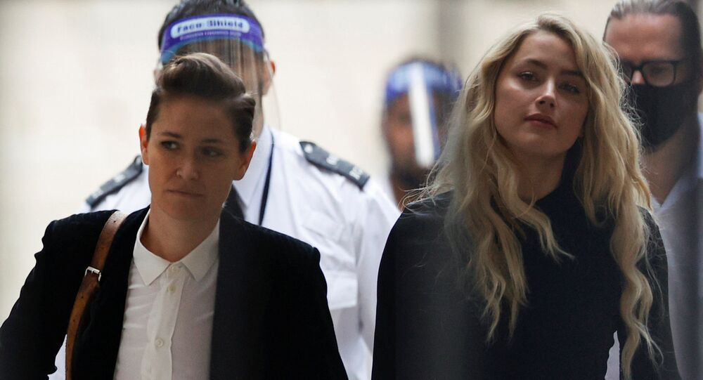 Actress Amber Heard (right) and her girlfriend, Bianca Butti, arrive at the High Court in London, on 28 July 2020.