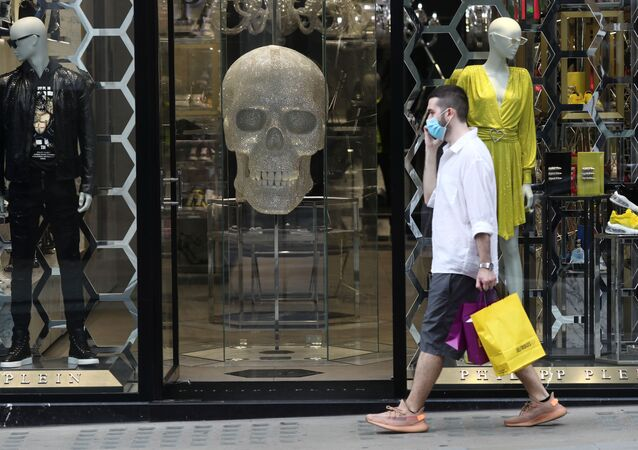 A man wearing a protective face mask walks down New Bond Street, as the spread of the coronavirus disease (COVID-19) continues, in London, UK, 24 July 2020