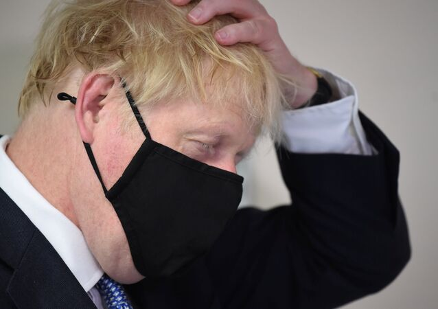 Britain's Prime Minister Boris Johnson visits the Tollgate Medical Centre in Beckton, London, Britain July 24, 2020