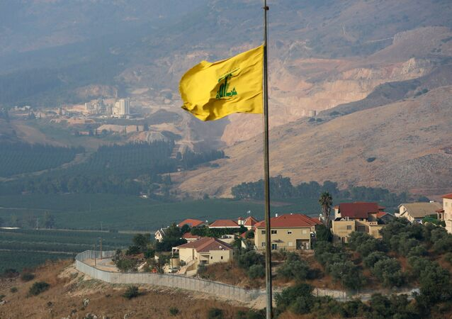 A Hezbollah flag flutters in the southern Lebanese village of Khiam, near the border with Israel, Lebanon July 28, 2020