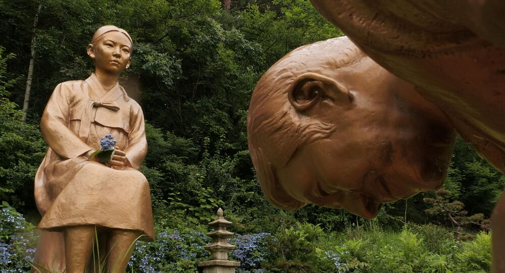 A statue symbolising Japanese Prime Minister Shinzo Abe taking a deep bow to comfort woman is pictured at Korea Botanic Garden in Pyeongchang, South Korea, 28 July 2020.