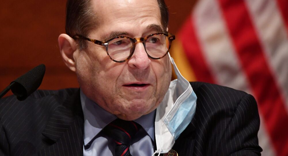 House Judiciary Committee Chairman Jerrold Nadler (D-NY) has his face mask partially removed at a House Judiciary Committee markup of H.R. 7120 the Justice in Policing Act, on Capitol Hill in Washington, U.S.,  June 17, 2020