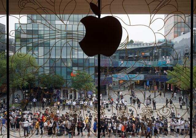 People line up outside the new Apple flagship store on its opening day following an outbreak of the coronavirus disease (COVID-19) in Sanlitun in Beijing, China, July 17, 2020