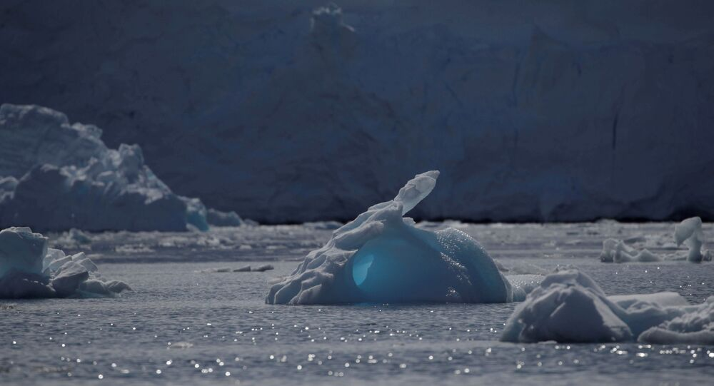 An iceberg floats along the water, close to Fournier Bay, Antarctica, 3 February 2020