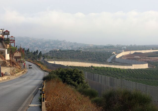 A vehicle drives in the southern Lebanese village of Kfar Kila, near the border with Israel, Lebanon July 28, 2020.